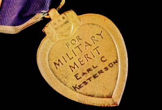 The back of the Purple Heart. It looks like his name was hand engraved.